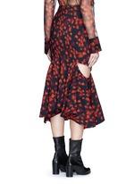 Cutout mermaid hem floral print skirt