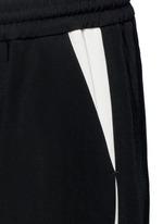 Contrast pocket stripe elastic twill pants