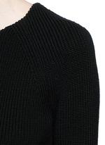 Sculptural moving peplum sleeve wool sweater