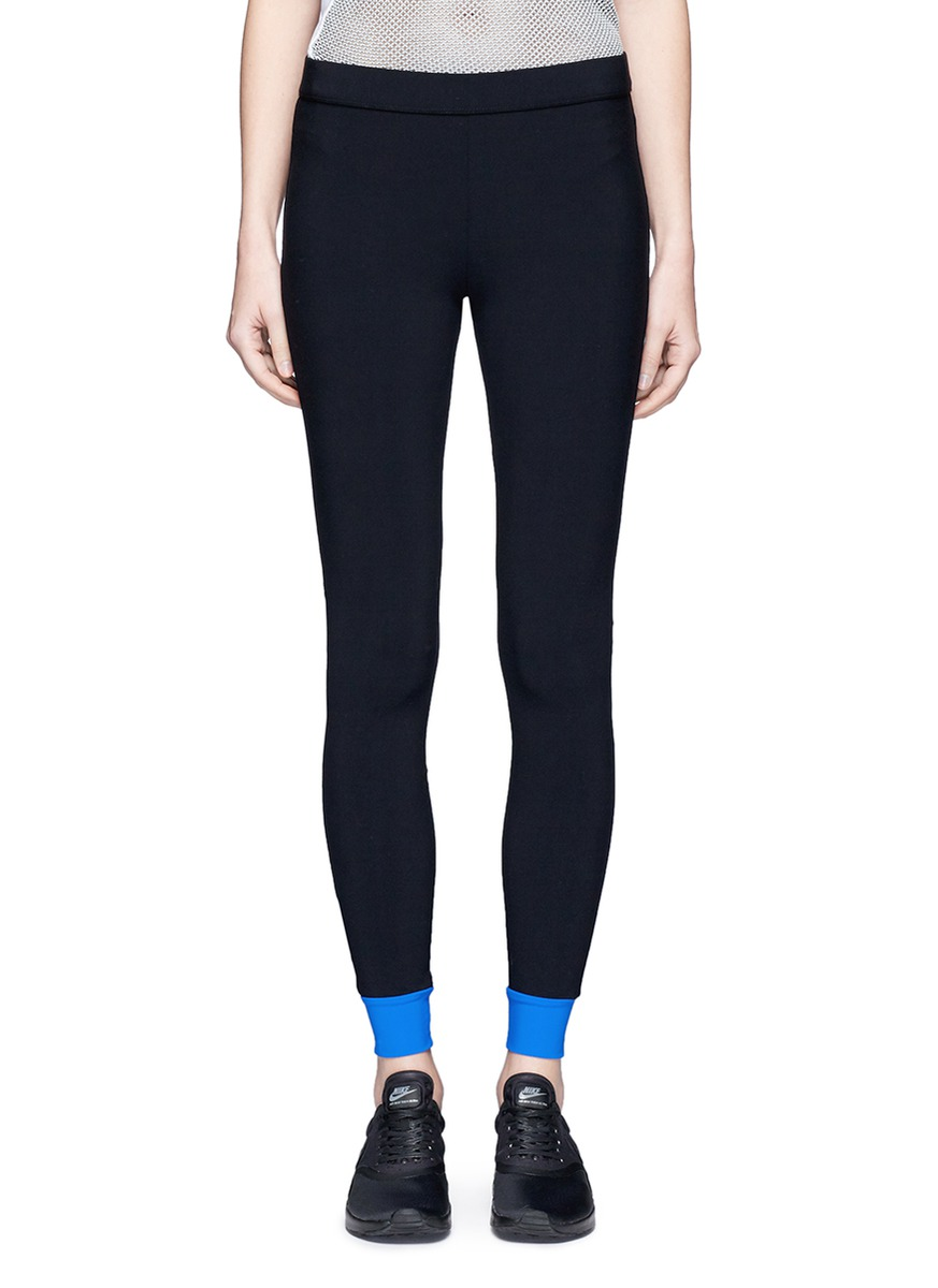 Colourblock performance leggings with gummed zip pouch by No Ka'Oi