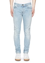 Repaired knee patch distressed skinny jeans