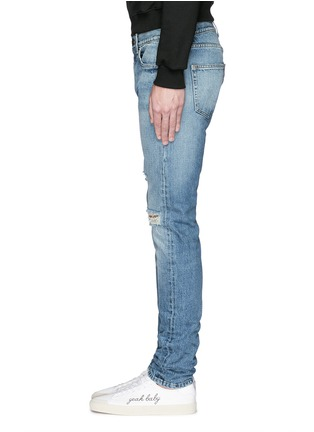 Saint Laurent - Destroyed knee patch skinny jeans