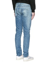 Destroyed knee patch skinny jeans