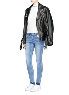 MO&Co.Ripped knee frayed cuff skinny jeans