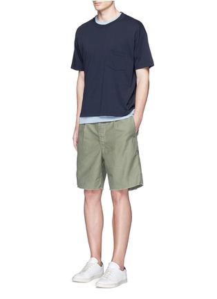 COVERT-Raw cuff cotton Bermuda shorts