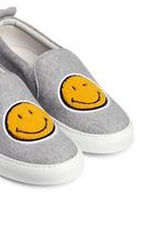 'Smile' fleece patch jersey skate slip-ons