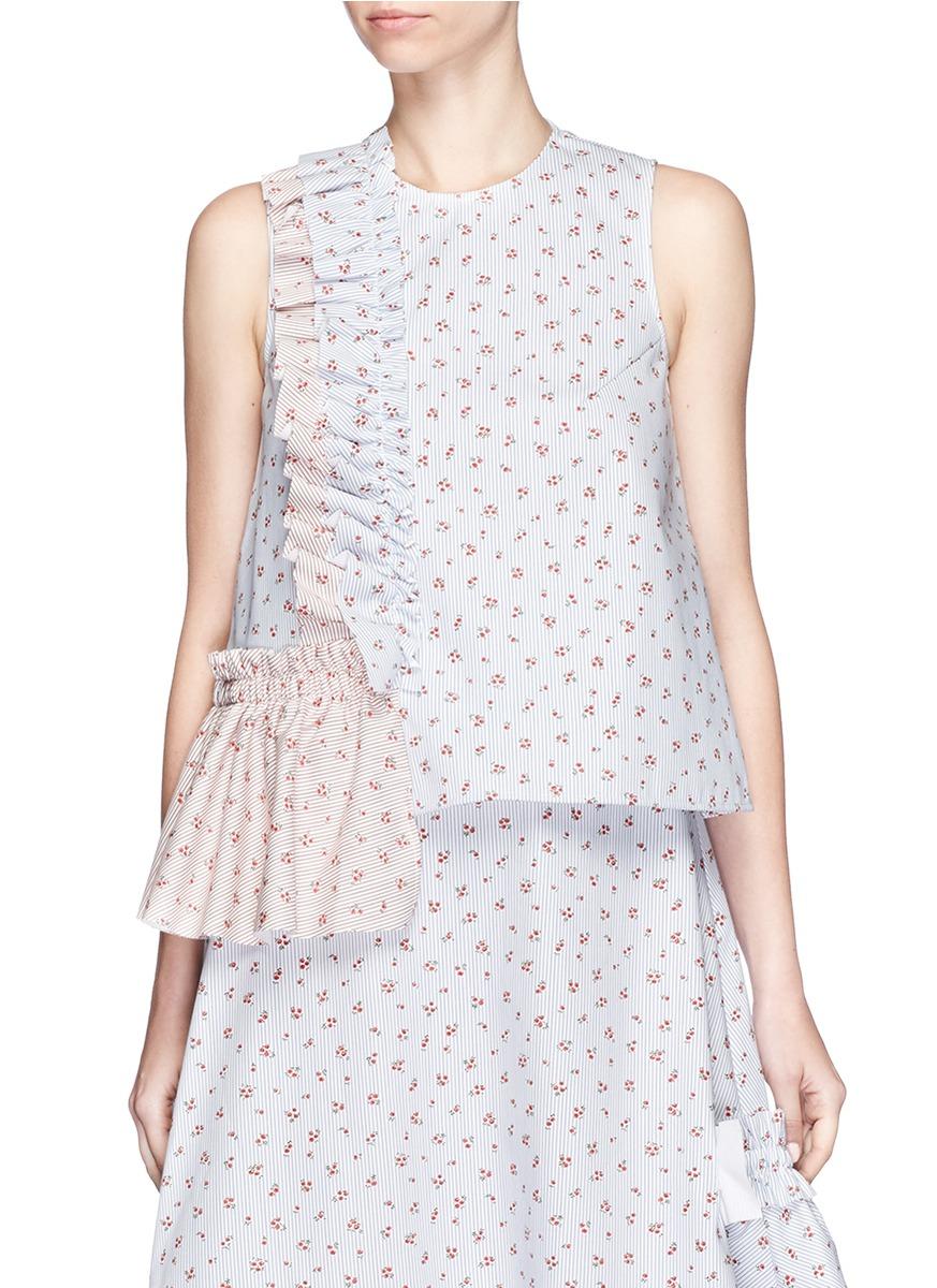 Ruffle trim floral print sleeveless top by Shushu/Tong