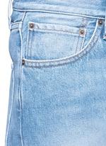 Dipped hem whiskered jeans
