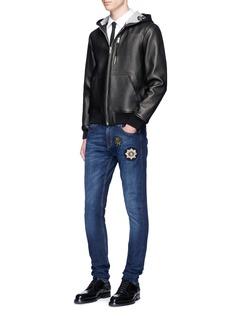 Alexander McQueenStar badge appliqué stretch jeans