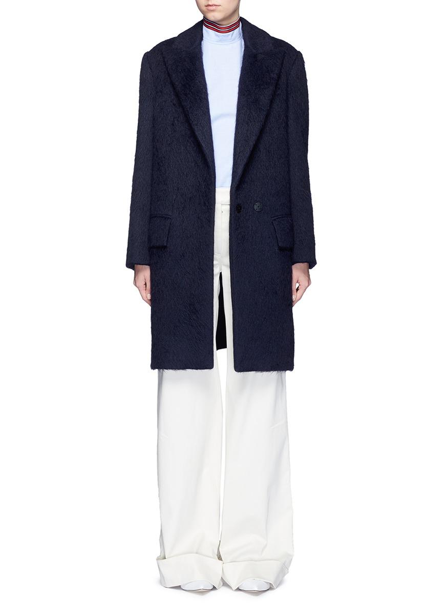 Peaked lapel oversized coat by Ms MIN