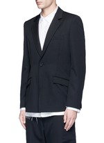 Back slit raw edge lining wool blazer