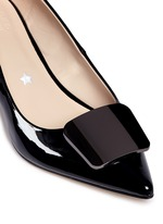 Riley' metal plaque patent leather pumps