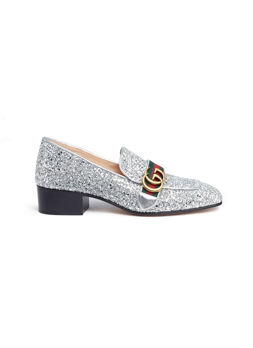 Web stripe glitter leather loafers by Gucci