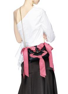 JW Anderson 'Pierce' ribbon bow barbell ring mini crossbody bag