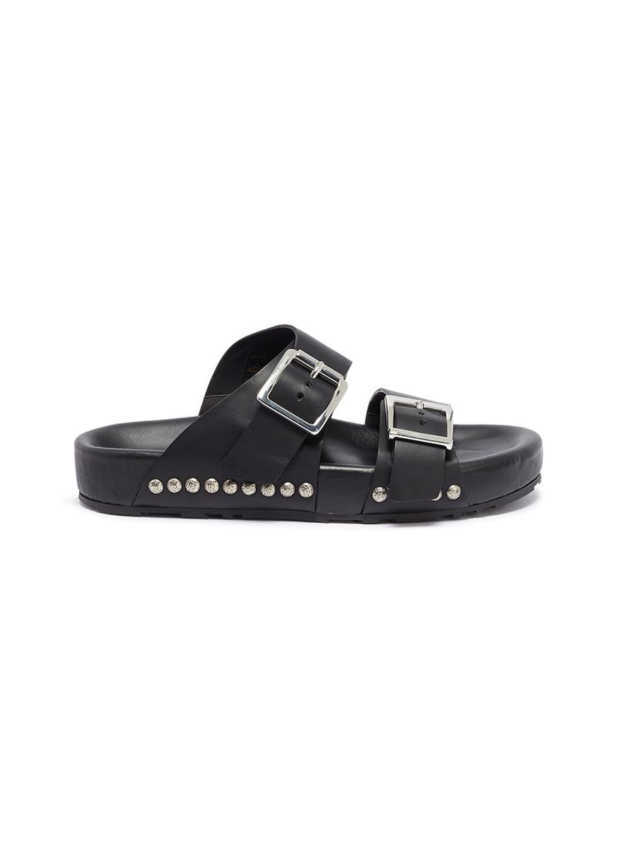 0bdd7705f3e8 Alexander McQueen. Hammered stud buckled leather slide sandals