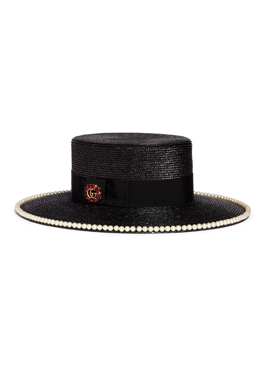 c7d32835c04d8 Gucci. Glass pearl logo brooch straw boater hat