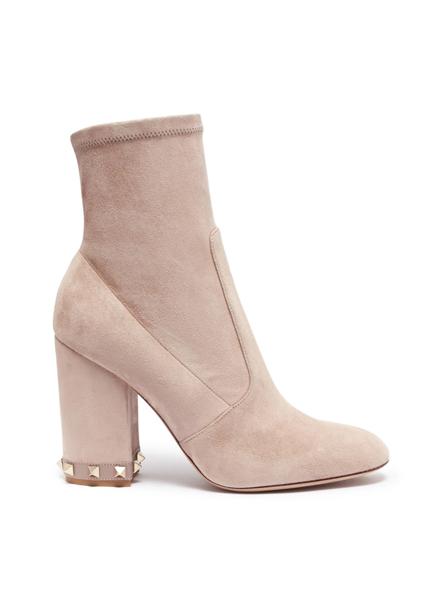 Rockstud stretch suede boots by Valentino