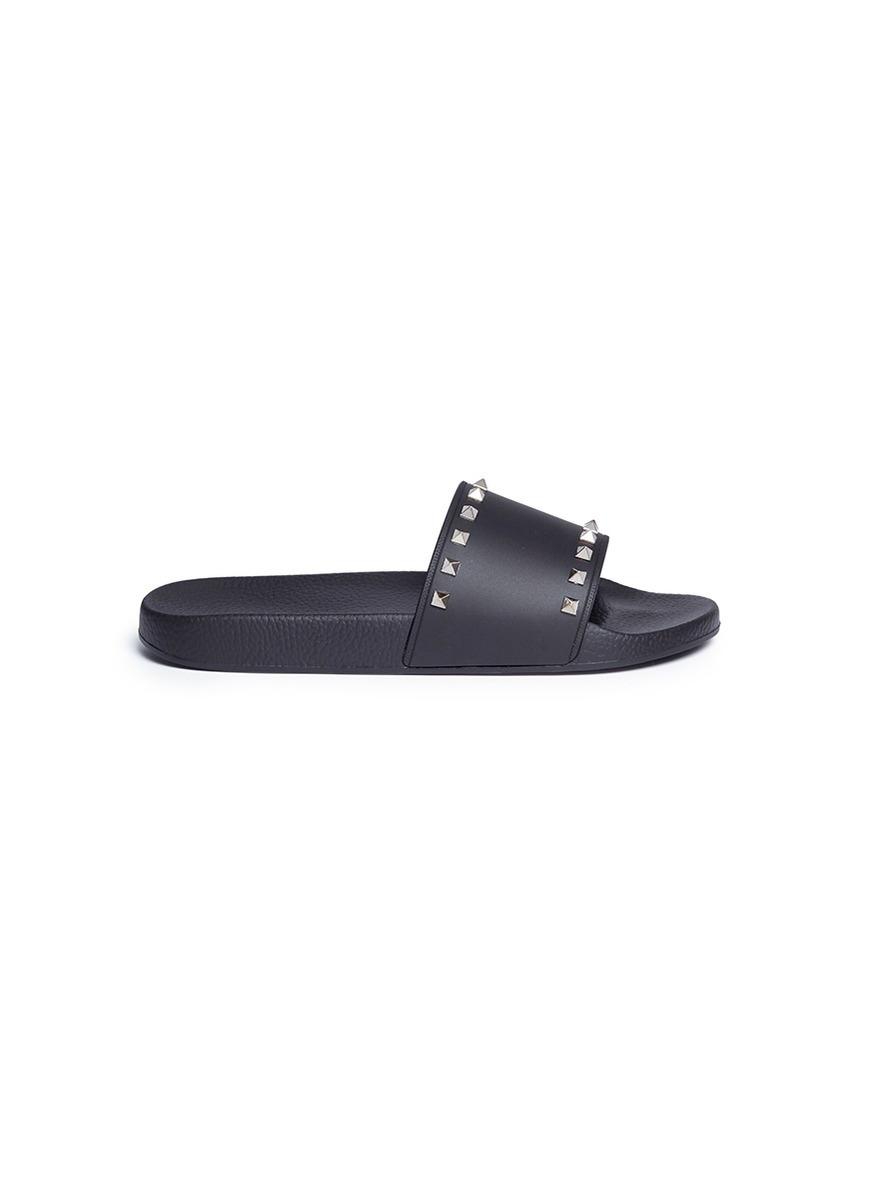 Rockstud slide sandals by Valentino
