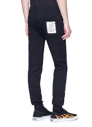 Back View - Click To Enlarge - Vetements - Label appliqué tapered leg sweatpants