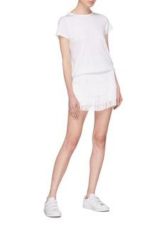 Norma Kamali Tiered fringe shorts