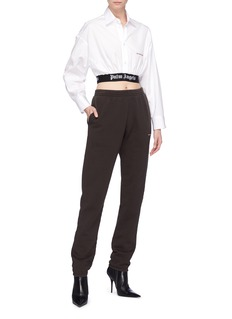 Palm Angels Slogan embroidered logo waistband cropped shirt