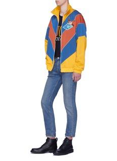 Gucci Logo bird appliqué chevron stripe jacket