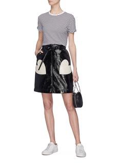 Alexa Chung Heart appliqué cracked PVC skirt