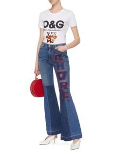 Dolce & Gabbana 'Amore' slogan heart appliqué patchwork flared jeans