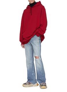Balenciaga Ripped boot cut jeans
