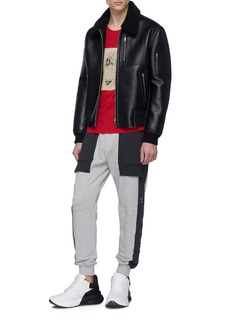 Alexander McQueen Logo embroidered stripe outseam jogging pants