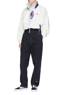 032c 'WWB Chevignon by 032c' slogan embroidered fleece jacket