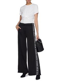 T By Alexander Wang Logo stripe outseam wide leg track pants