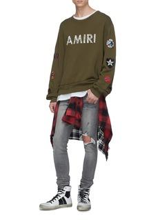 Amiri Ripped glitter jeans