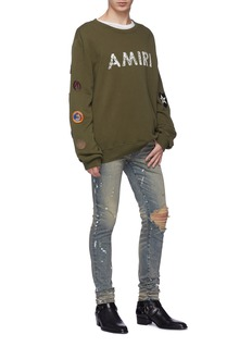 Amiri 'Artist' paint splatter ripped skinny jeans
