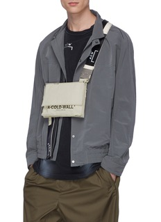 A-COLD-WALL* Logo print leather patch canvas utility bag