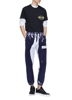 D.TT.K Crumple Dye' label graphic print sweatpants