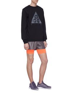SIKI IM CROSS Layered running shorts