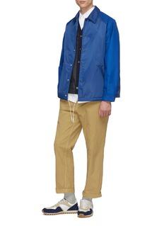 Comme Des Garçons Homme Logo print raglan sleeve oversized coach jacket