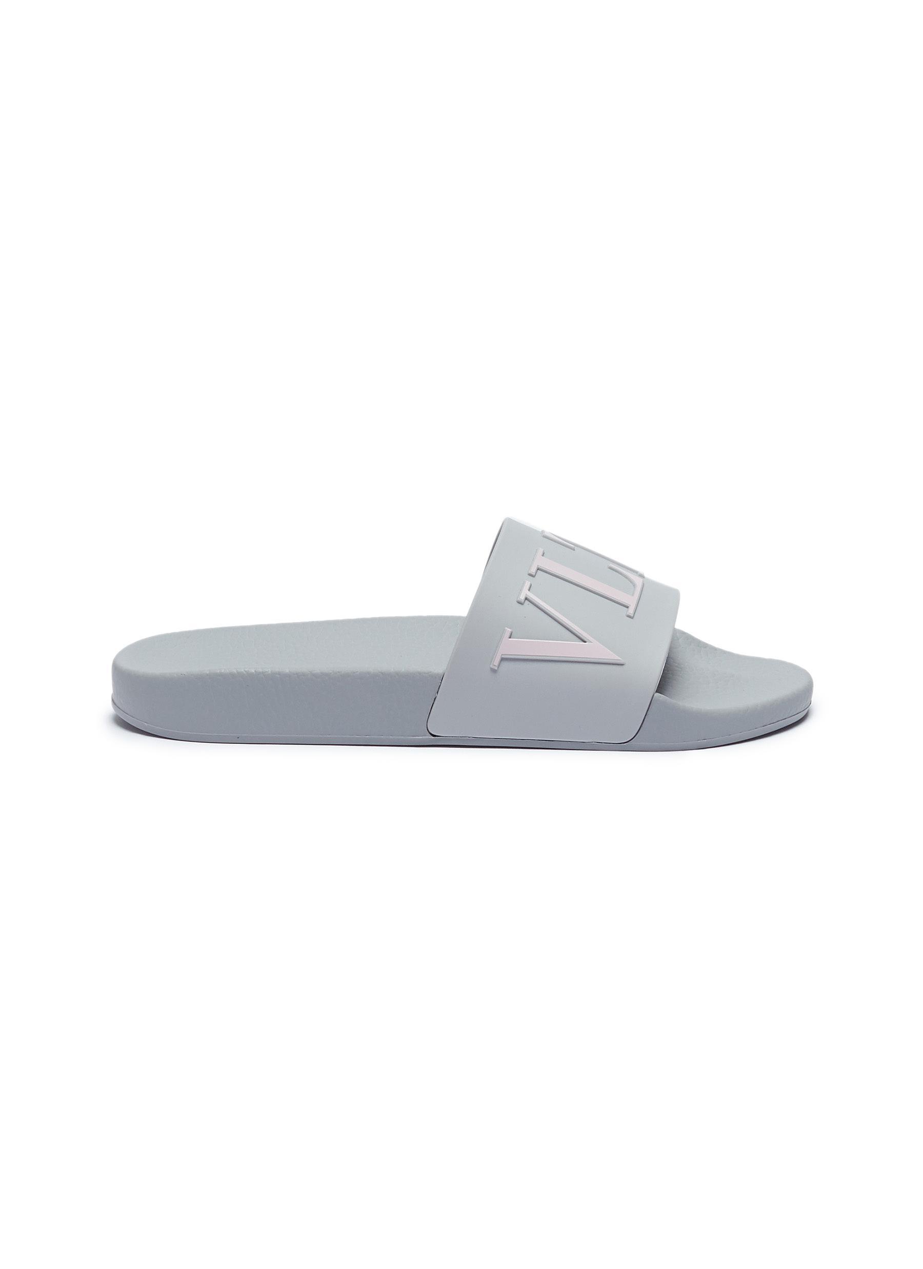 Logo print slide sandals by Valentino