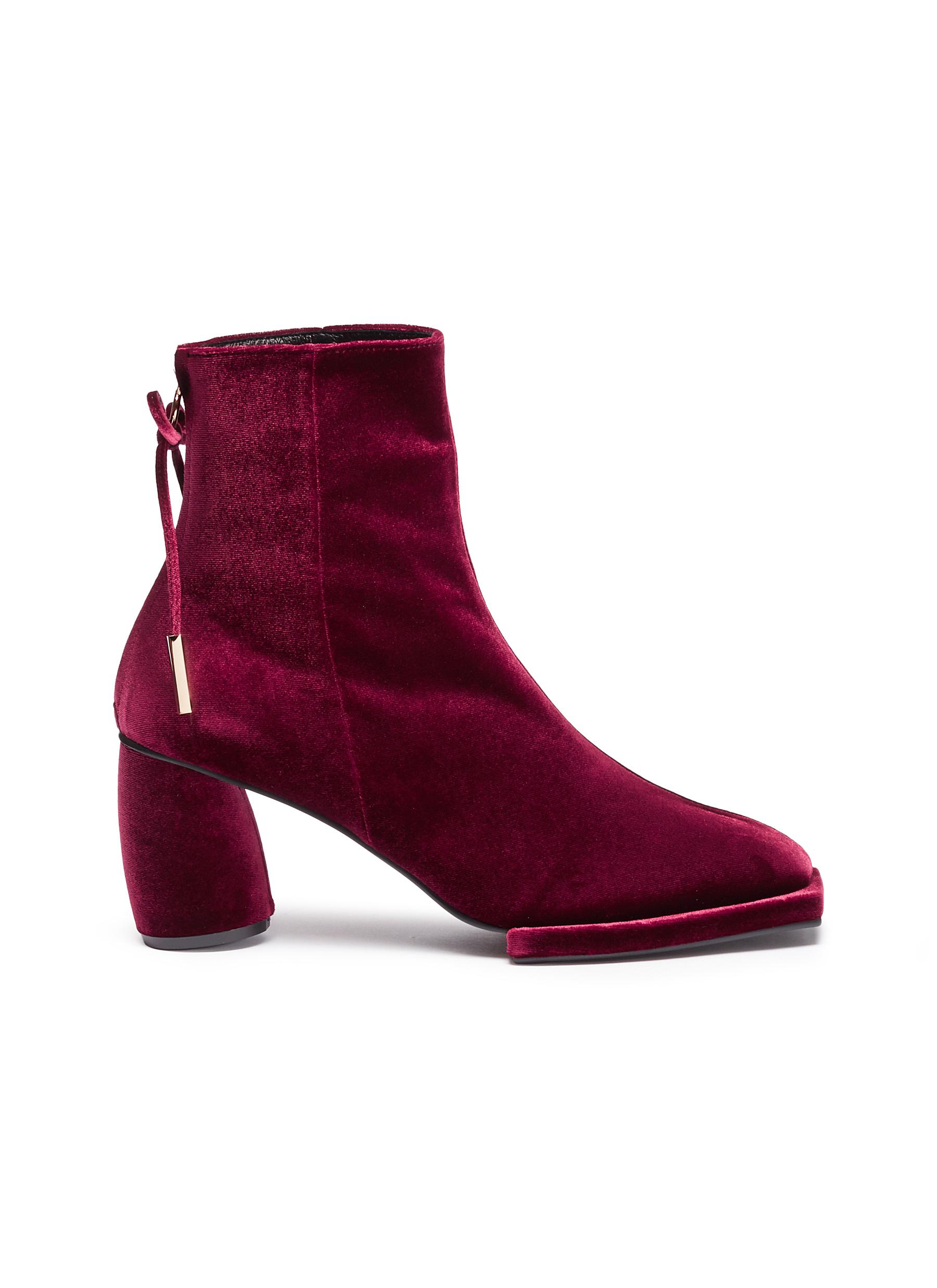 Bow zip velvet ankle boots by REIKE NEN