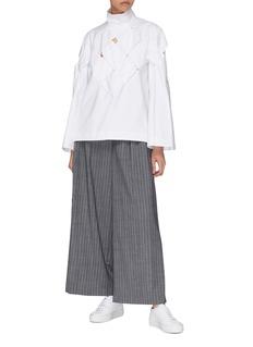 The Keiji Cutout lattice yoke poplin turtleneck blouse