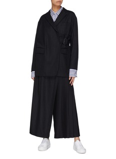 The Keiji Buckled wrap overlay pinstripe wool twill pants