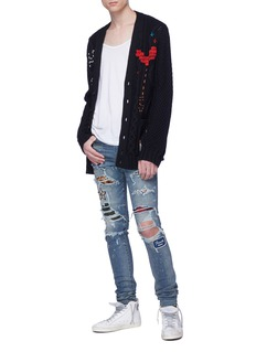 Amiri Mix appliqué paint splatter ripped skinny jeans