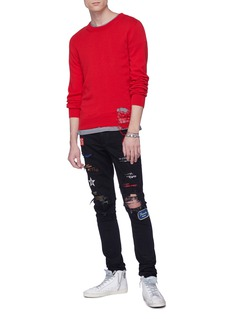 Amiri Mix appliqué ripped skinny jeans