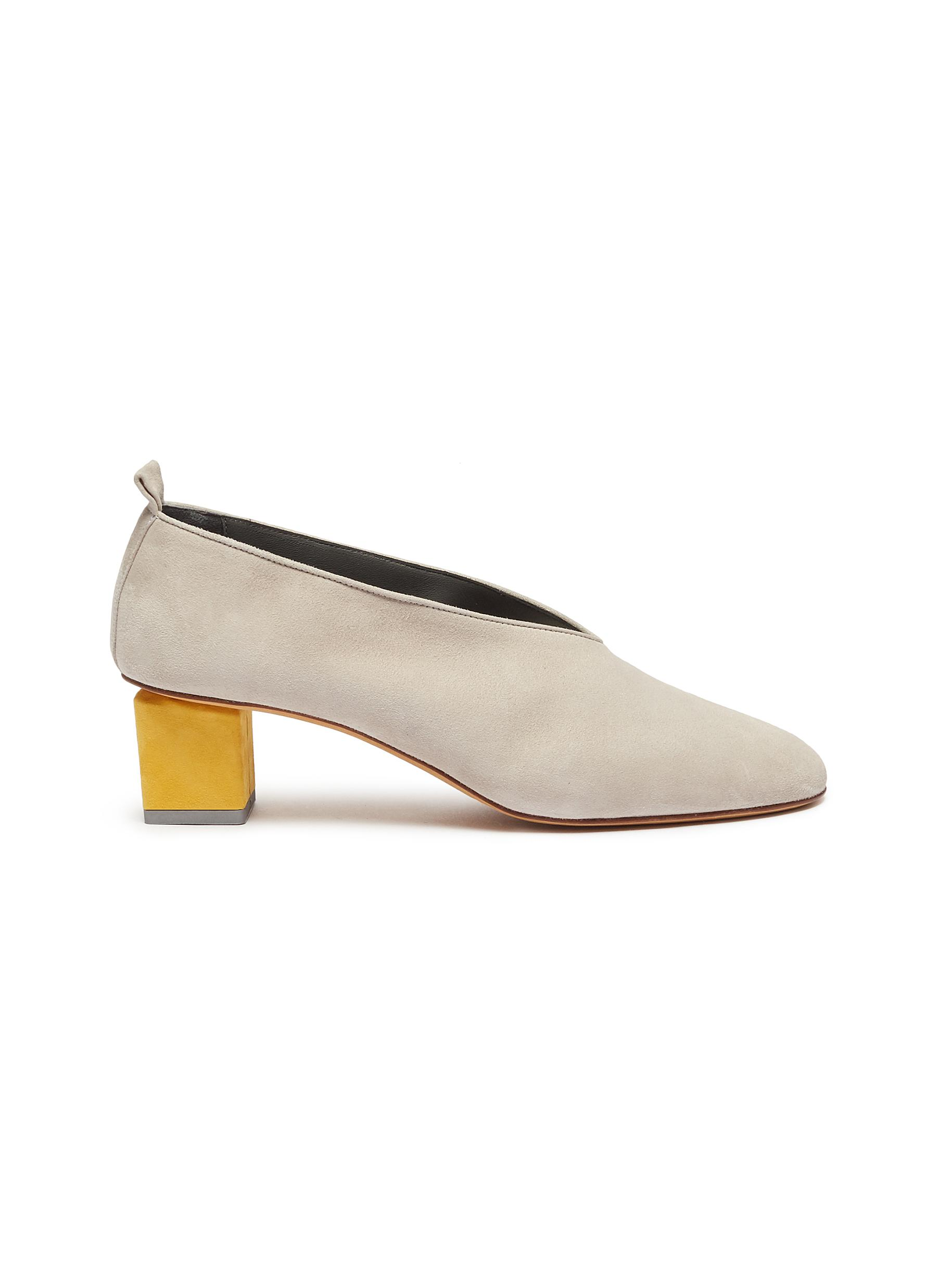 Mildred geometric heel choked-up suede pumps by Gray Matters