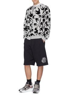 McQ Alexander McQueen Swallow velvet flock print panelled sweatshirt