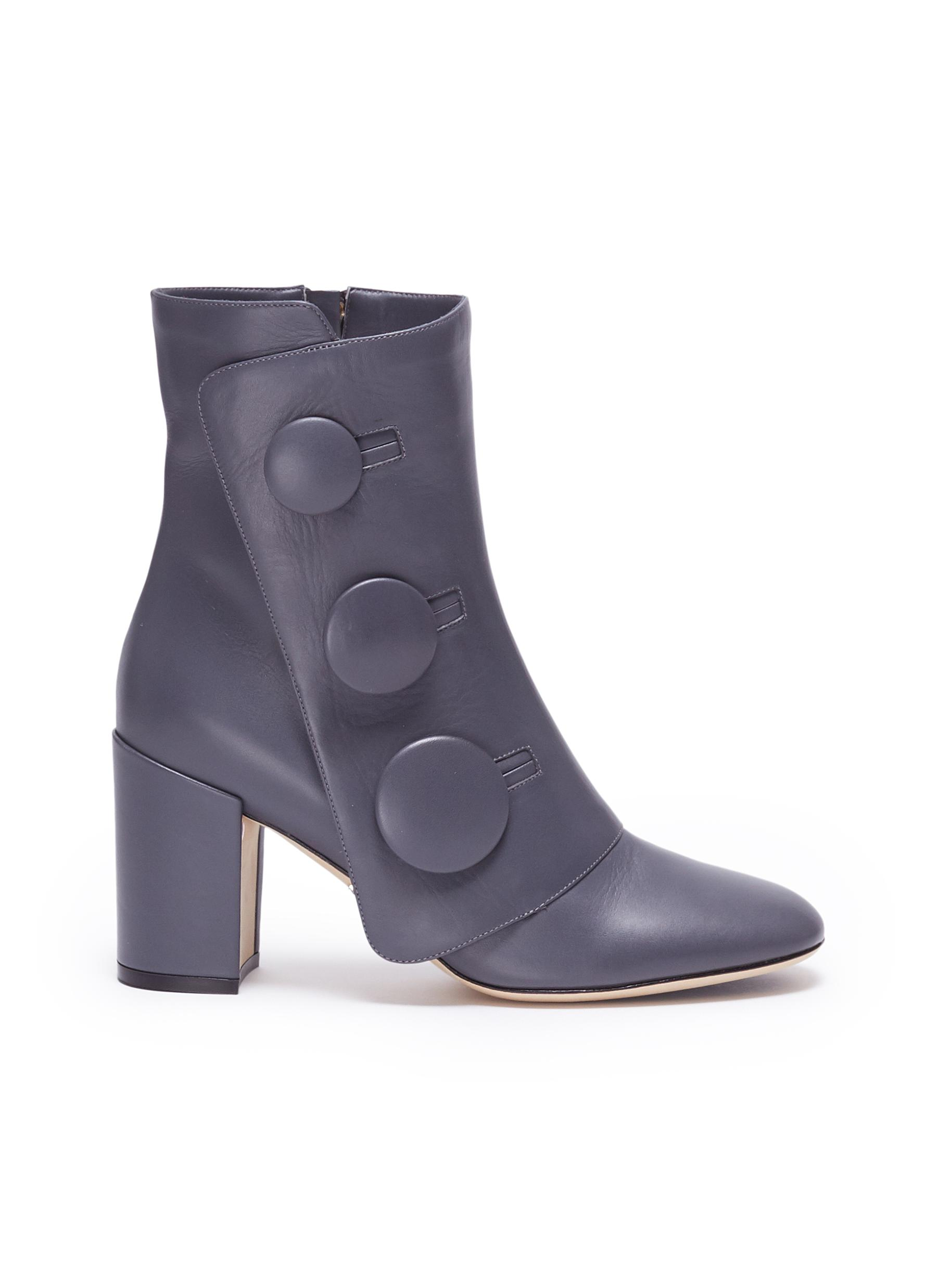 Mock button flap leather ankle boots by RODO