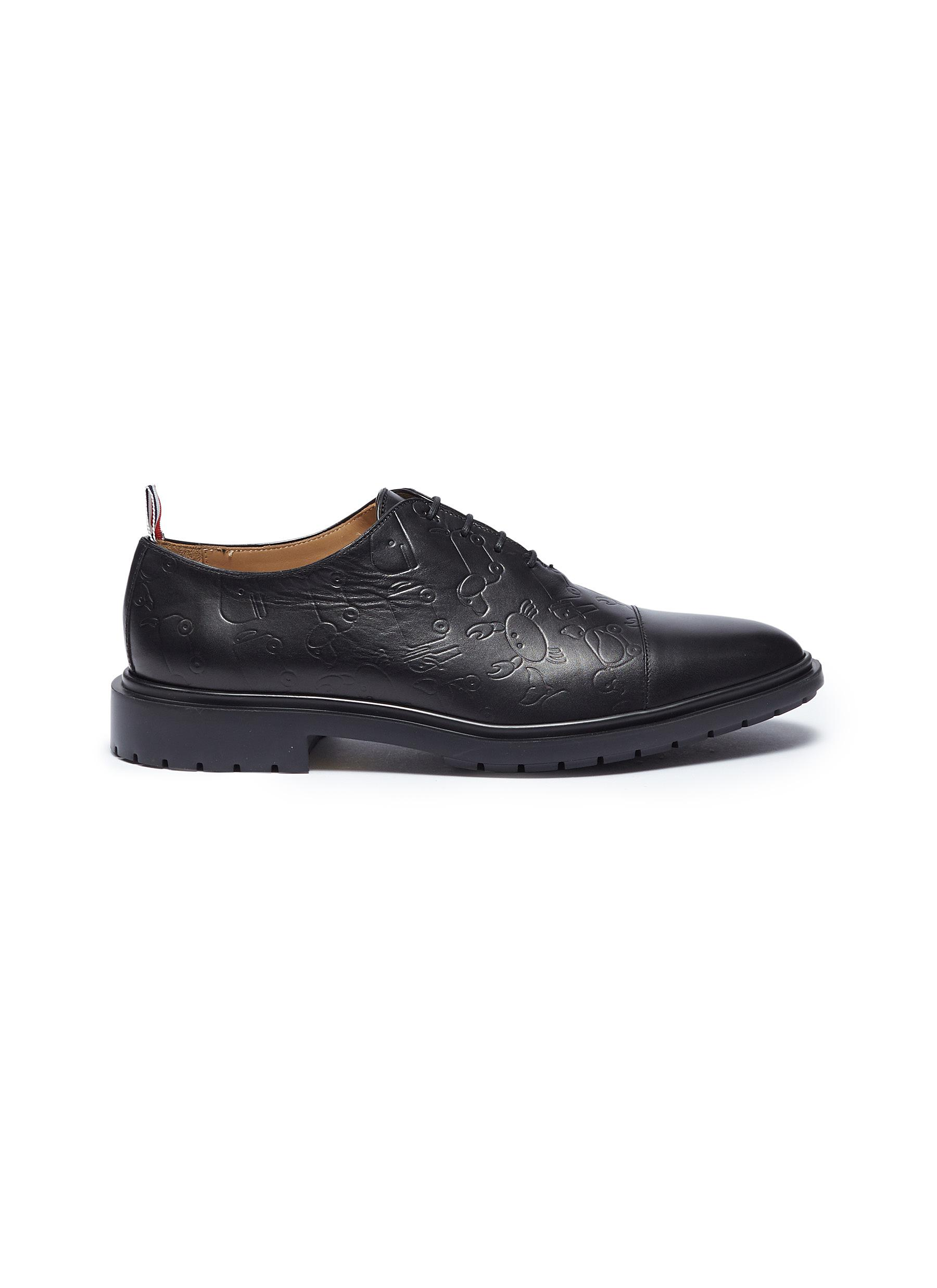 Graphic embossed leather shoes by Thom Browne