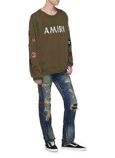NOVE Rip-and-repair slim fit jeans