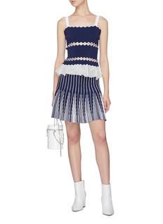 PH5 Wavy cutout knit peplum camisole top